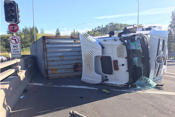 Truck written-off after rollover on highway