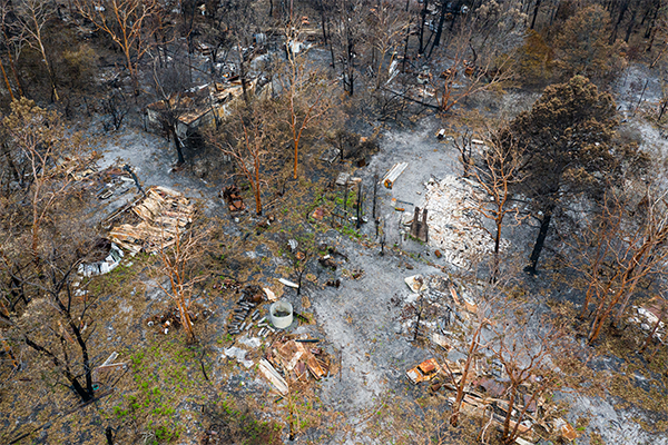 Article image for Bushfire-ravaged locals living in tents unable to access millions in donations