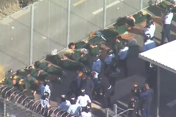 'That's very regrettable': Long Bay locals flee from tear gas used in prison riot