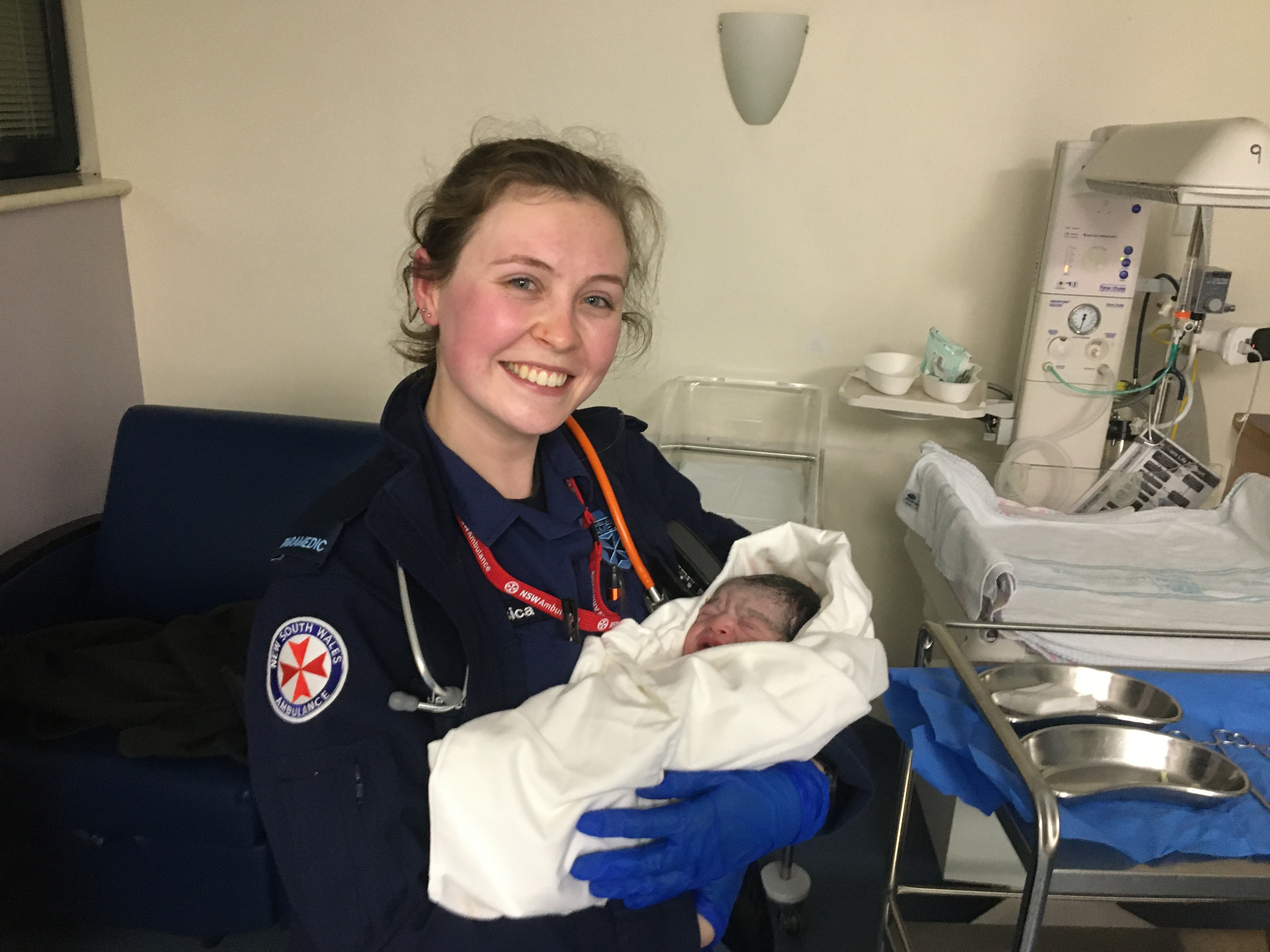 EXCLUSIVE | Baby's dramatic entrance into the world makes a young paramedic's dream come true