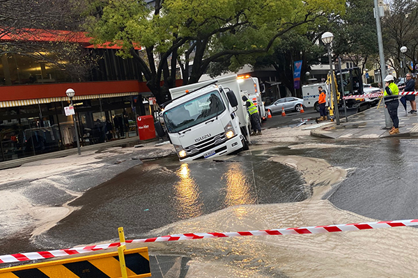 PHOTOS | Truck caught in Double Bay sinkhole