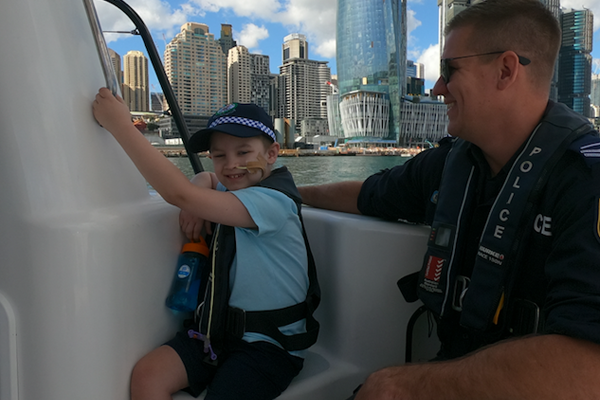 Article image for Young cancer fighter lives his dream day with NSW police