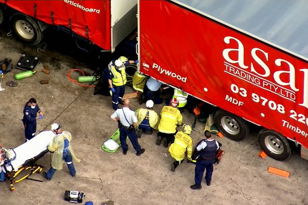 Article image for Incredibly lucky escape after man crushed by a truck at a service station