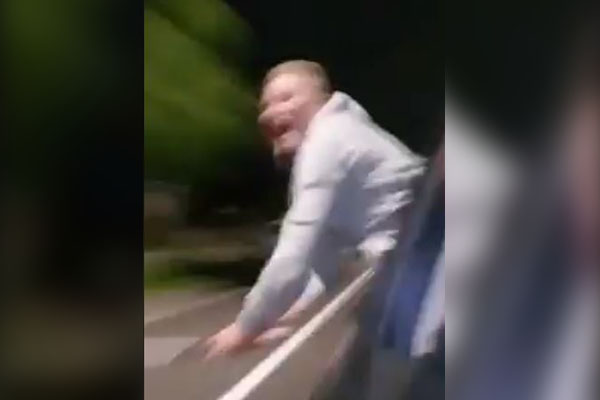 Article image for WATCH | 'Lunatic' armed with baseball bat swings at cars in Sydney