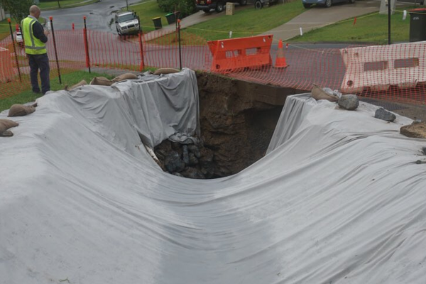 Article image for Sinkhole swallows Coffs Harbour street