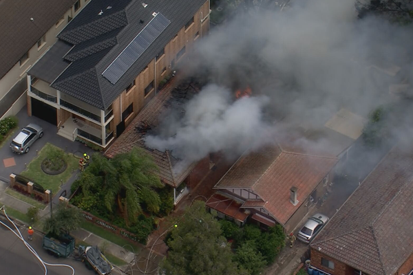 Article image for Blaze sparks dozens of Triple Zero calls and blankets Lakemba in smoke