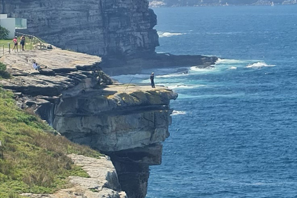 Article image for 'Moron' spotted fishing off cliff edge in Sydney's east