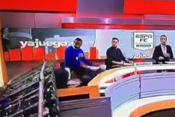 Horrifying moment journalist crushed by set on live TV
