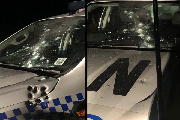 Article image for Police car shot at during dramatic standoff