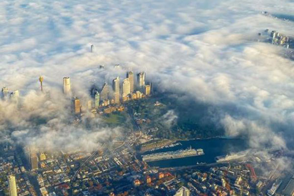 Article image for Sydney shrouded in fog and smoke haze