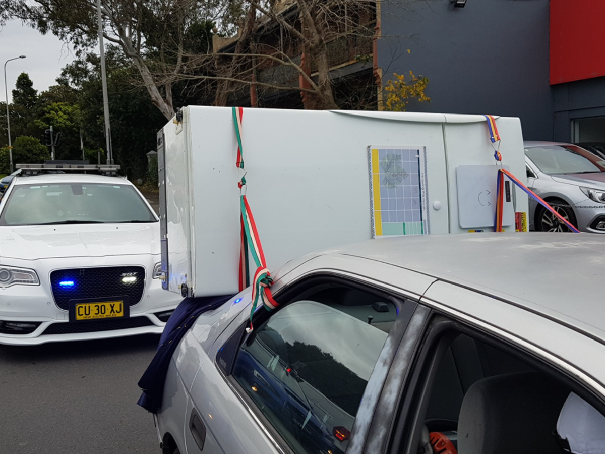 Article image for Police catch 'some lunatic' driving with fridge strapped to car's boot