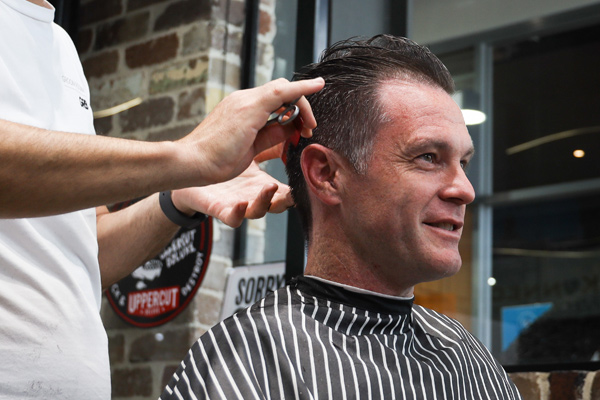 Article image for Chris Minns hits the Groom Room for 'world's most expensive haircut'