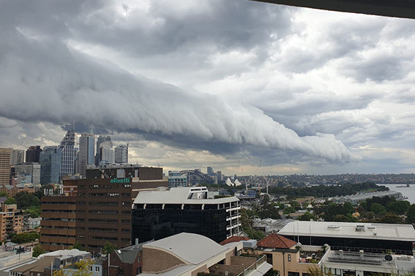 Article image for Dark storm clouds roll across Sydney Harbour
